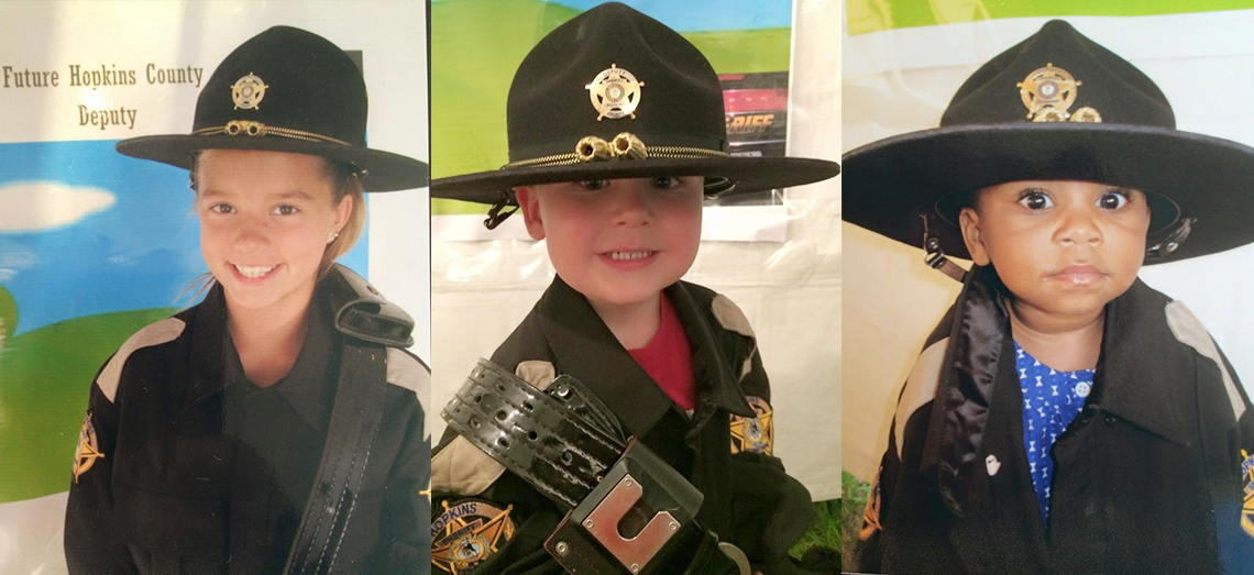 Photo of three children in officer uniform